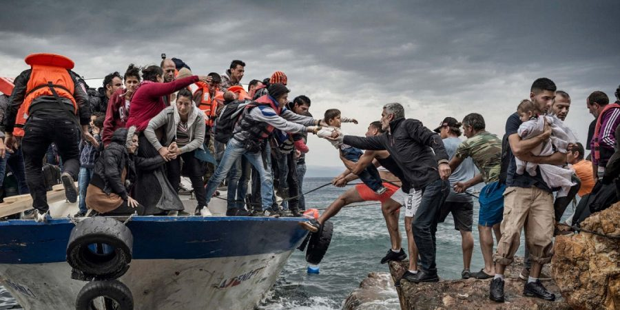 Oct. 11, 2015 - Lesbos Island, Greece - Refugees and Migrants aboard fishing boat driven by smugglers reach the coast of the Greek Island of Lesbos after crossing the Aegean sea from Turkey. Creator: Antonio Masiello for Freelance